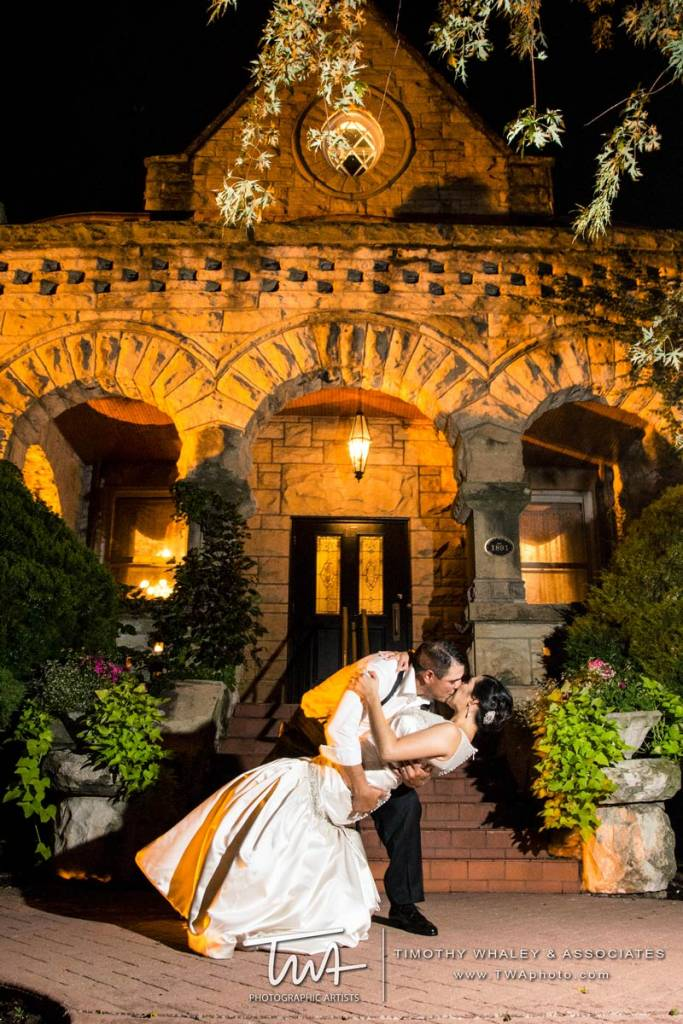 couple kissing outside wedding reception venue