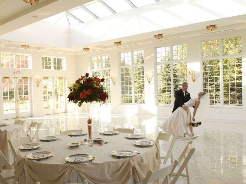 couple dancing in beautiful indoor wedding venue