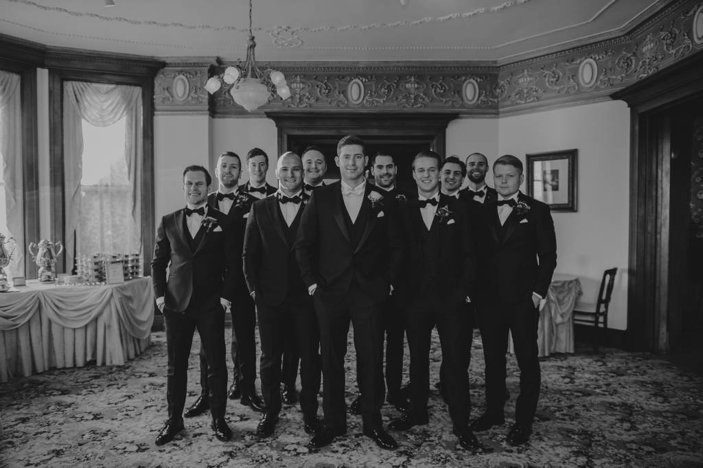 Groomsmen portrait at antique wedding reception hall