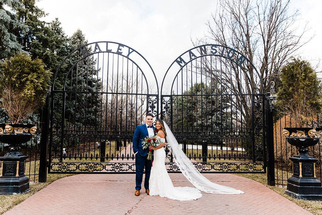 The Haley Mansion Gate and Couple